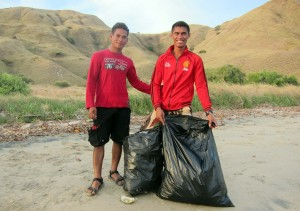 Fauzi and Yadi clean the beach in the Komodo National Park